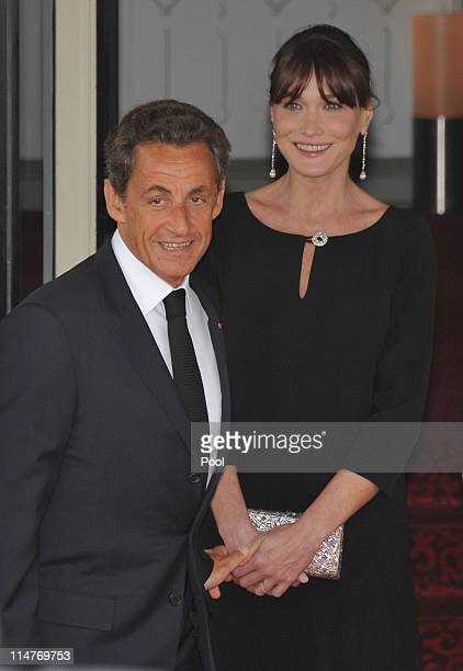 French President Nicolas Sarkozy and his pregnant wife Carla BruniSarkozy await the arrival of G8 member state leaders and their spouses at Le Ciro's...