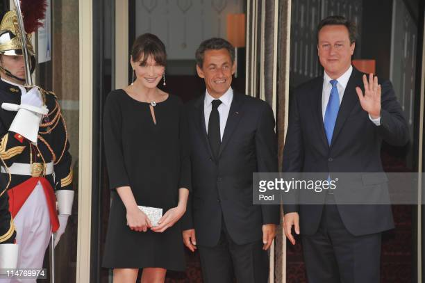 French President Nicolas Sarkozy and his pregnant wife Carla BruniSarkozy greet British Prime Minister David Cameron upon Cameron's arrival at Le...