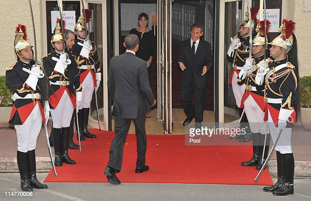 French President Nicolas Sarkozy and his pregnant wife Carla BruniSarkozy greet US President Barack Obama upon Obama's at Le Ciro's Restaurant at the...