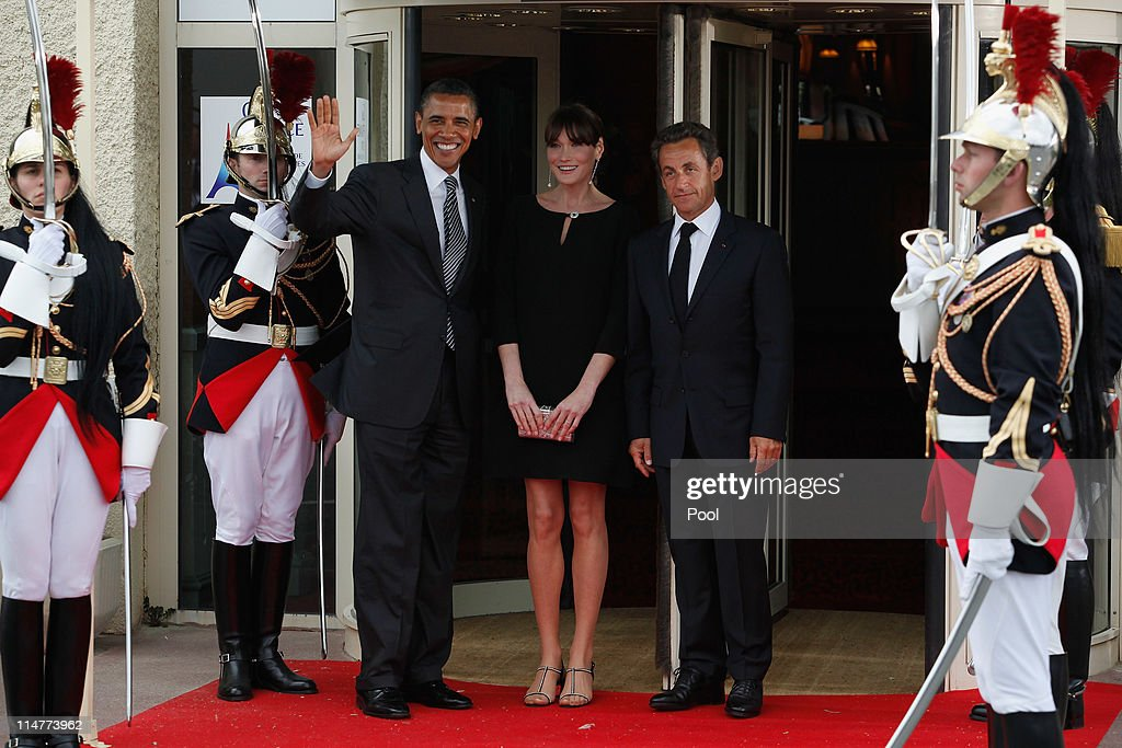 French President Nicolas Sarkozy (R) and his pregnant wife Carla Bruni-Sarkozy greet U.S. President Barack Obama upon Obama's arrival at Le Ciro's Restaurant at the G8 Summit on May 26, 2011 in Deauville, France. France is hosting the G8 Summit, which focuses on issues including African development, the Arab Spring and the Internet.