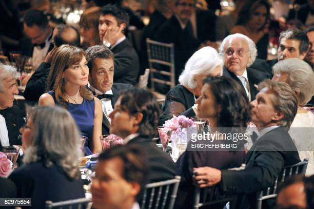 French President Nicolas Sarkozy and his wife Carla BruniSarkozy attend a ceremony with US actor Michael Douglas and his wife Catherine ZetaJones...