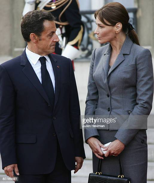 French president Nicolas Sarkozy and his wife Carla BruniSarkozy greet Pope Benedict XVI as he leaves the courtyard of the Elysee Palace on September...