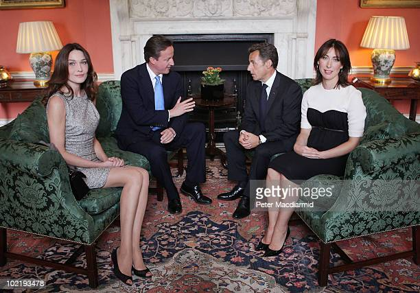French President Nicolas Sarkozy and his wife Carla BruniSarkozy sit with Prime Minister David Cameron and his wife Samantha Cameron inside Number 10...