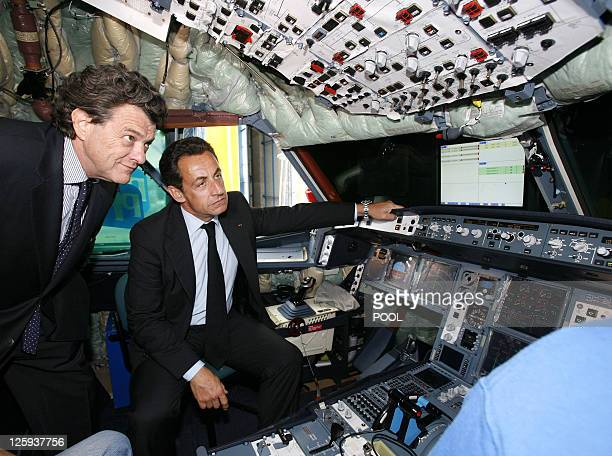 French President Nicolas Sarkozy and new Economy and Finance minister JeanLouis Borloo visit the cabin of a A330 Airbus in built 18 May 2007 at the...