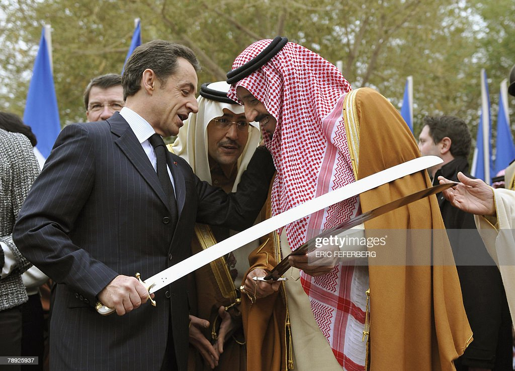 French President Nicolas Sarkozy (L) and Saudi Prince Salman Abdelaziz al Saud (R), brother of King Abdullah, joke with a sabre during a Saudi traditional war dance, 14 January 2008 at the Royal Palace in Riyadh. Sarkozy is on a three-day visit to Gulf countries -- Saudi Arabia, Qatar and Abu Dhabi.