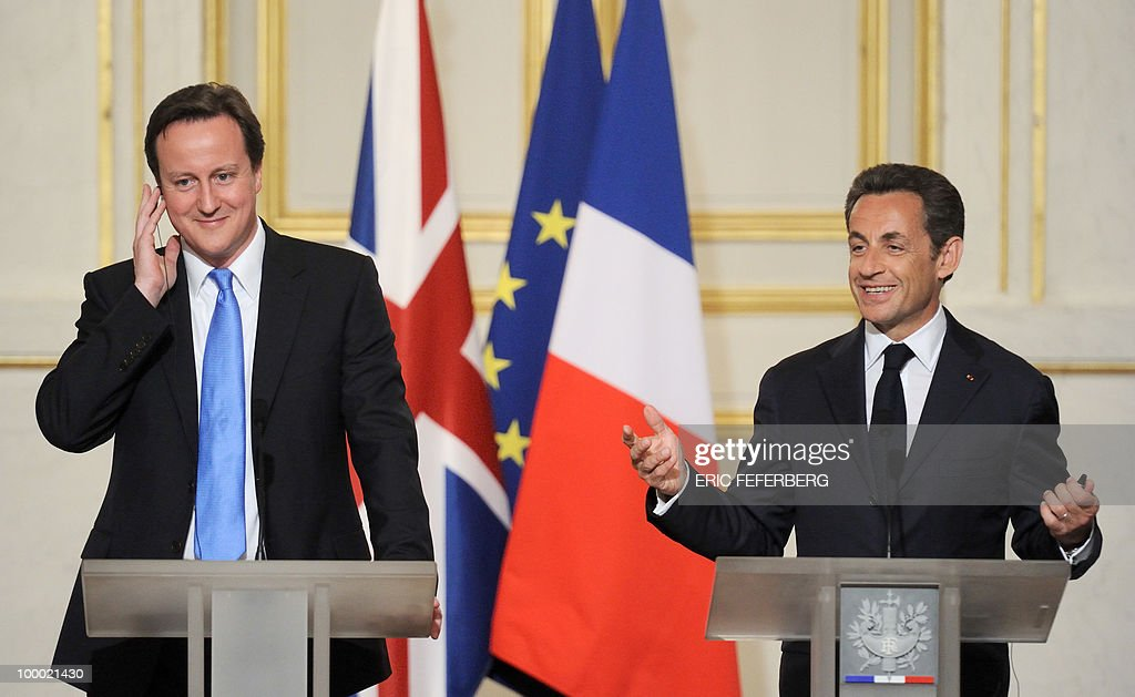French President Nicolas Sarkozy (R) and the new Britain's Prime Minister David Cameron give a press conference following their diner at the Elysee Palace on May 20, 2010 in Paris. Cameron and his coalition deputy unveiled full details today of their 'historic' power-sharing deal, under growing scrutiny for signs of strain.