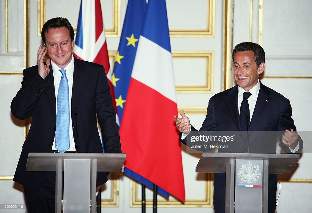 French President Nicolas Sarkozy (R) and the new British Prime minister David Cameron give a press conference after their dinner at the Elysee Palace on May 20, 2010 in Paris. Cameron and his coalition deputy unveiled full details today of their 'historic' power-sharing deal, which is being put under growing scrutiny in search of signs of strain.