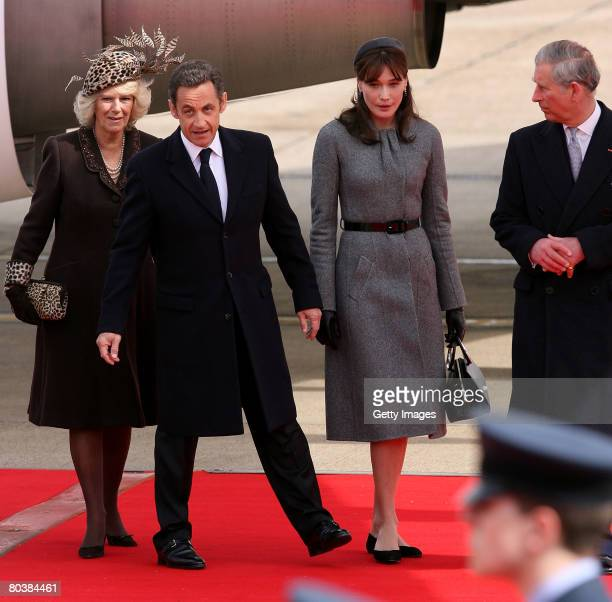 French President Nicolas Sarkozy and wife Carla BruniSarkozy are greeted at Heathrow by Prince Charles Prince of Wales and Camilla Duchess of...