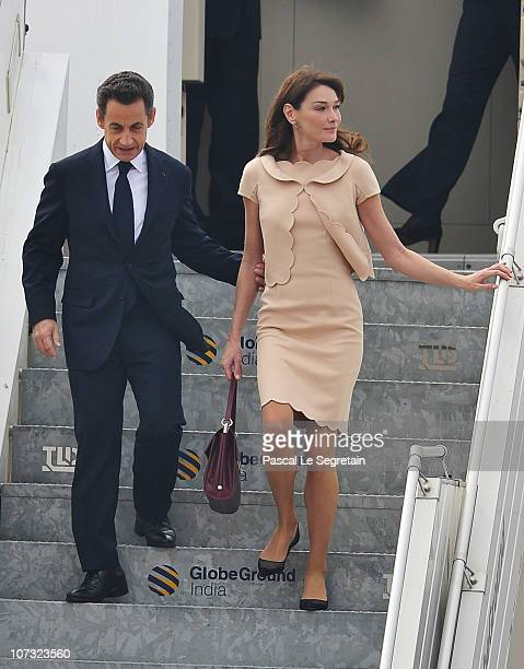 French President Nicolas Sarkozy and wife Carla BruniSarkozy arrive at Hal Airport on December 4 2010 in Bangalore India French President Nicolas...