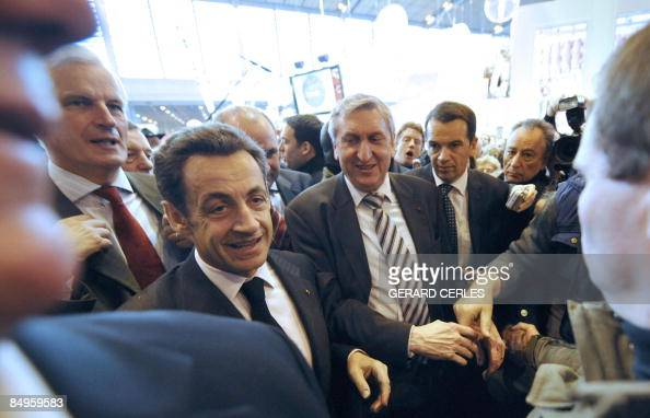 French President Nicolas Sarkozy following by Agriculture Minister Michel Barnier and President of the National Federation of Agricultural unions...