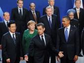 French President Nicolas Sarkozy gestures as German Changellor Angela Merkel USPresident Barack Obama and China Prime Minister Hu Jintao pose for a...