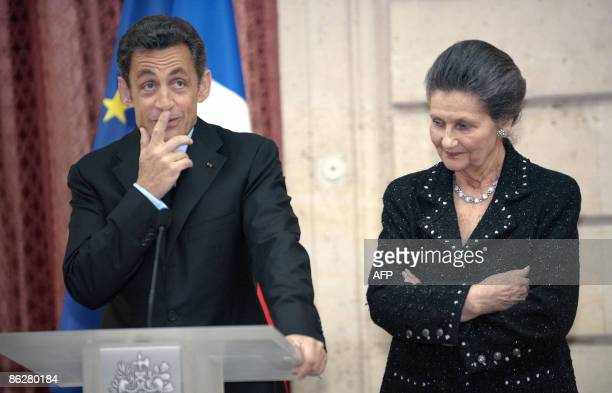 French President Nicolas Sarkozy gestures as he delivers a speech prior to awarding French former minister and European Parliament President Simone...