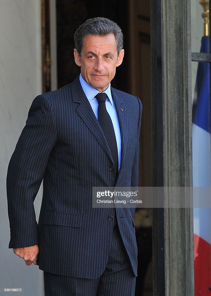 French President Nicolas Sarkozy greets Palestinian Authority President Mahmoud Abbas at Elysee Palace in Paris France