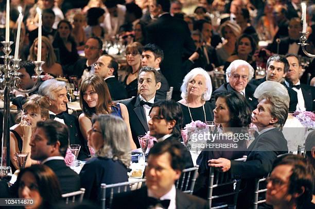 French President Nicolas Sarkozy his wife Carla BruniSarkozy attends an award ceremony with US actor Michael Douglas and wife Catherine ZetaJones...
