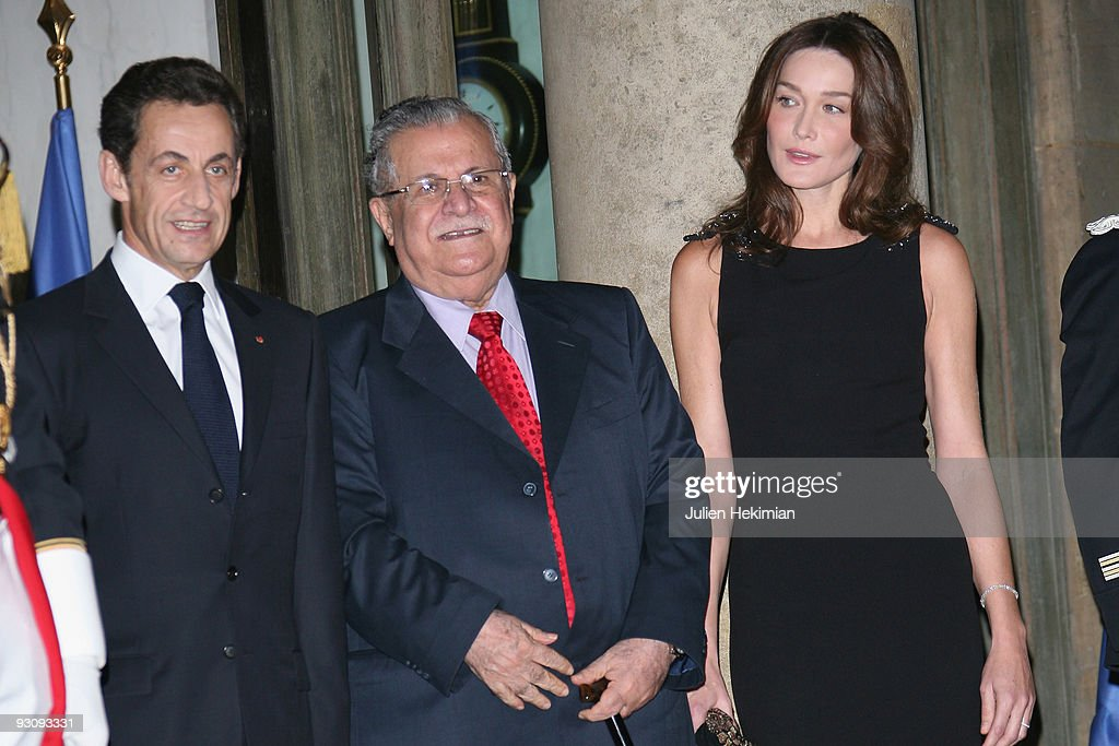 French president Nicolas Sarkozy, Iraq president Jalil Talabani and Carla Bruni-Sarkozy attend the dinner honoring Iraq President Jalil Talabani at Elysee Palace on November 16, 2009 in Paris, France.