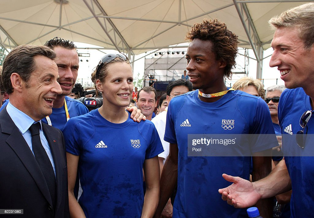 French President Nicolas Sarkozy (L) is greeted by French swimmers Laure Manaudou (3rd R) and Alain Bernard (R), and tennis players Michael Llodra (2nd L) and Gael Monfils (2nd R), as he pays a visit to the French Olympic athletes at the Olympic village on August 8, 2008 in Beijing, China. Sarkozy is due to go to the Great Hall of the People at Tiananmen Square to attend a banquet hosted by his Chinese counterpart Hu Jintao for the heads of state and government ahead of the 2008 Beijing Olympic Games opening ceremony.