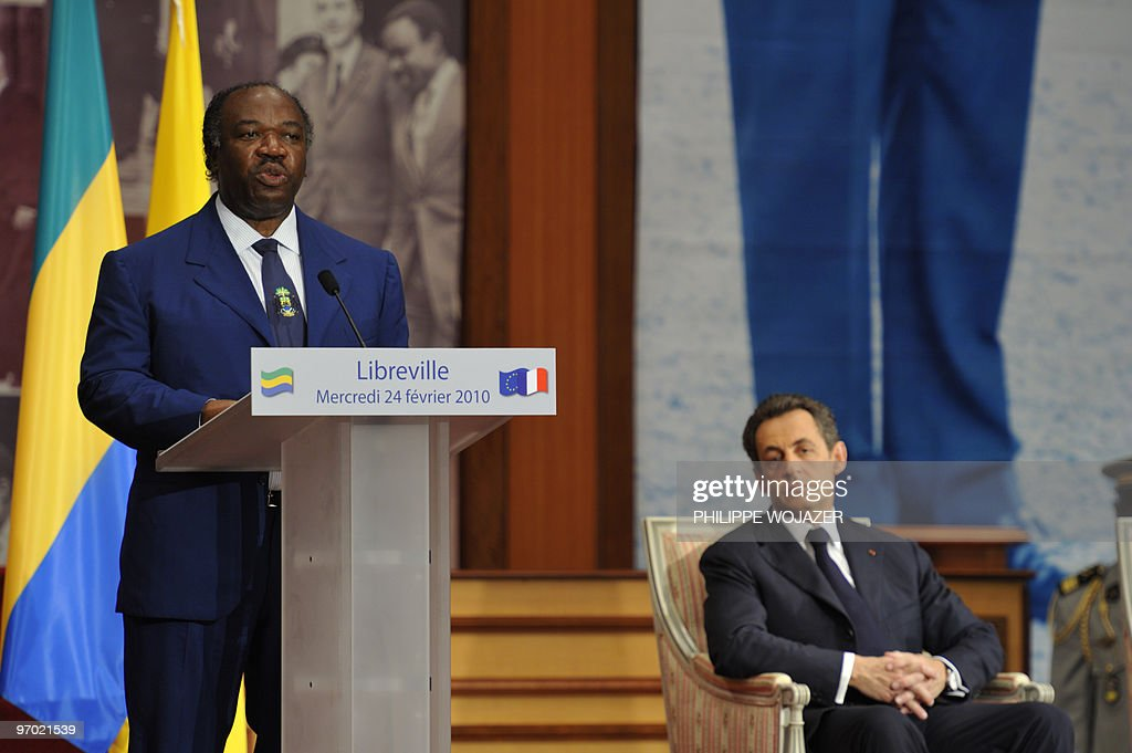 French President Nicolas Sarkozy listens to the speech of his Gabonese counterpart Ali Bongo Ondimba in Libreville on February 24 2010 Sarkozy on...