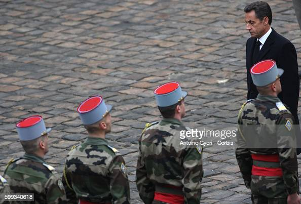 French President Nicolas Sarkozy pays his respects to former French politician and president of the Cour des Comptes Philippe Seguin during a funeral...