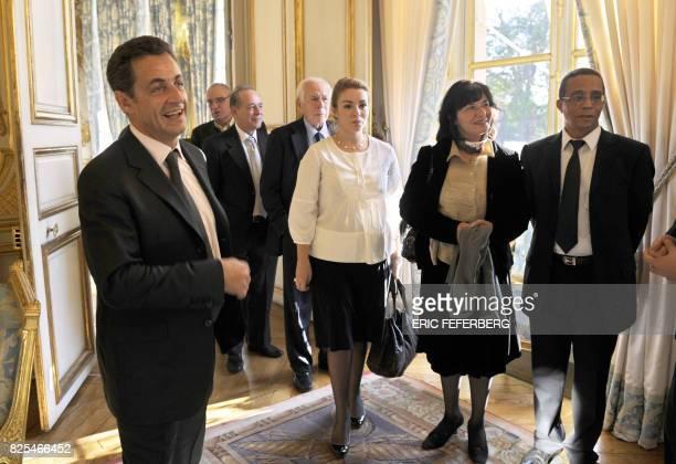 French President Nicolas Sarkozy poses next to writers Richard Millet JeanNoel Pancrazy Jean Daniel Yasmine Ghata Colette Fellous and Yasmina Khadra...
