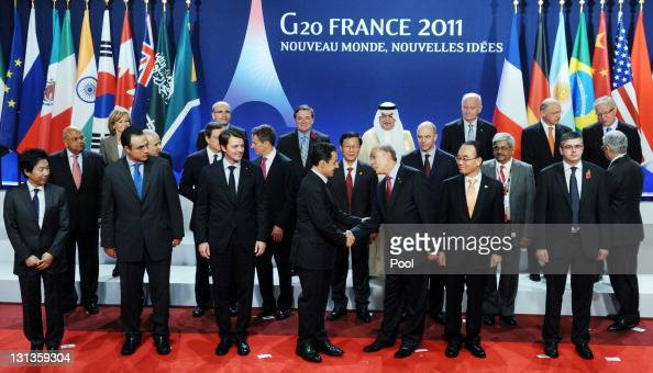 French President Nicolas Sarkozy speaks with G20 Finance Ministers on the second day of the G20 Summit on November 4 2011 in Cannes France World's...