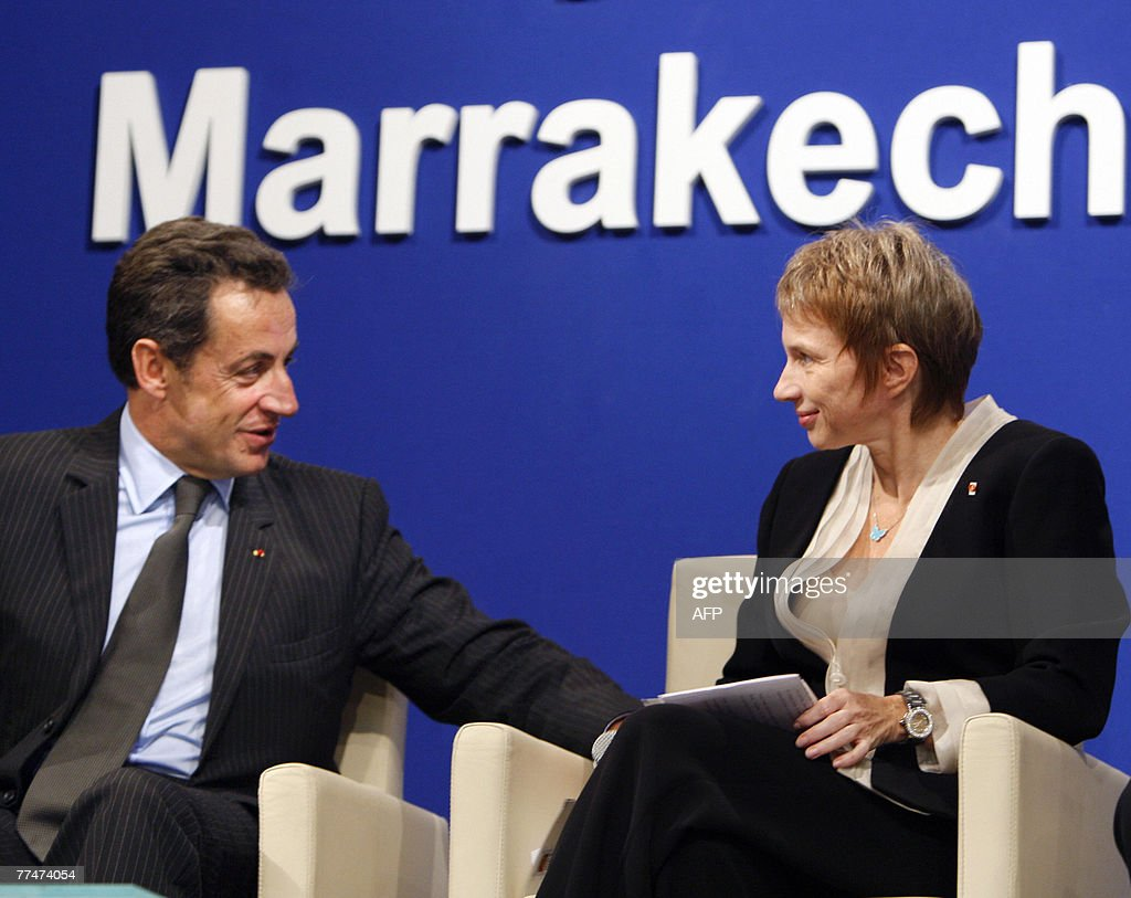 French President Nicolas Sarkozy speaks with head of the Medef employers' union Laurence Parisot at a French and Moroccan businessmen meeting in...