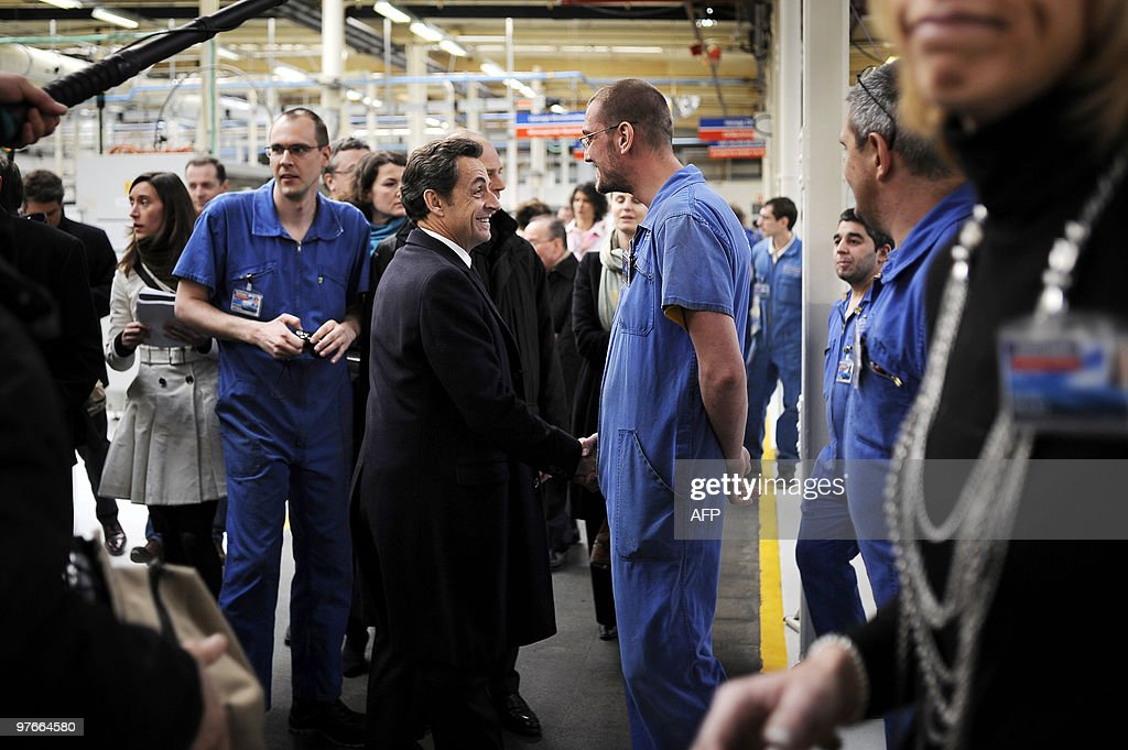 French President Nicolas Sarkozy (C), speaks with workers, on March 9, 2010 in Pontarlier, eastern France, in the French tyre and valve manufacturer Schrader, during a visit dedicated to employment and professional training.