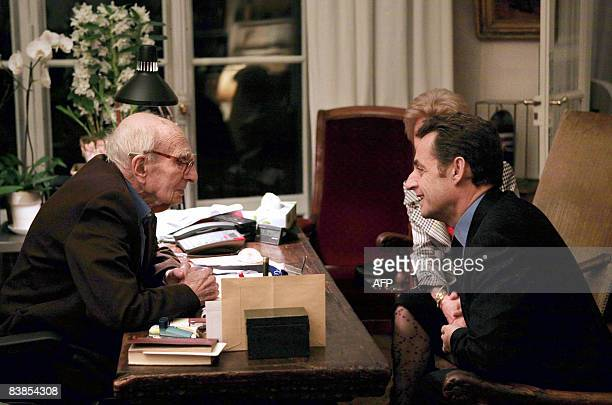 French president Nicolas Sarkozy talks with French philosopher author and anthropologist Claude LeviStrauss on November 28 during a visit to...