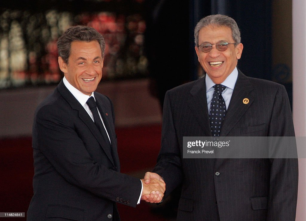 French President <a gi-track='captionPersonalityLinkClicked' href=/galleries/search?phrase=Nicolas+Sarkozy&family=editorial&specificpeople=211375 ng-click='$event.stopPropagation()'>Nicolas Sarkozy</a> welcomes <a gi-track='captionPersonalityLinkClicked' href=/galleries/search?phrase=Amr+Moussa&family=editorial&specificpeople=213955 ng-click='$event.stopPropagation()'>Amr Moussa</a>, Secretary General of the League of Arab States, as he arrives at day two of the G8 summit on May 27, 2011 in Deauville, France. The Tunisian Prime Minister, Beji Caid el Sebsi, and Egyptian Prime Minister, Essam Sharaf, are due to meet with G8 leaders today to discuss aid packages as the recent Arab Spring uprisings continue to dominate the talks. Furthermore, the meeting will address security, trade issues, nuclear safety and climate change.