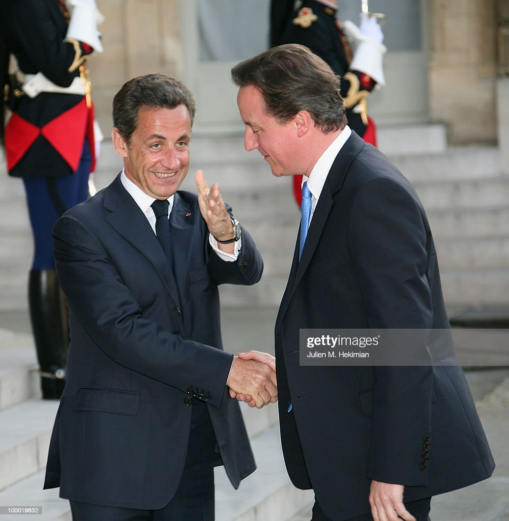 French President Nicolas Sarkozy (L) welcomes British Prime Minister David Cameron prior to a working dinner at the Elysee Palace on May 20, 2010 in Paris, France.