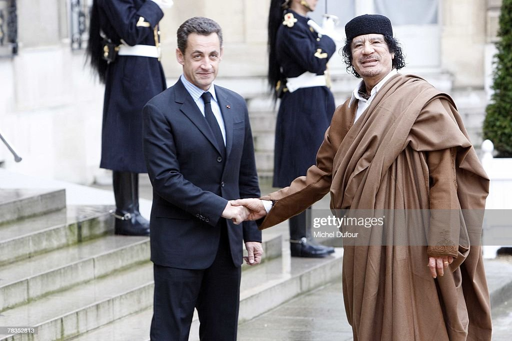 French President Nicolas Sarkozy welcomes Colonel Gaddafi at Le palais de l'Elysee on December 10, 2007 in Paris, France. The Libyan leader <a gi-track='captionPersonalityLinkClicked' href=/galleries/search?phrase=Muammar+Gaddafi&family=editorial&specificpeople=202172 ng-click='$event.stopPropagation()'>Muammar Gaddafi</a> will spend five days in France, his first visit in over 30 years, to discuss trade and military deals.