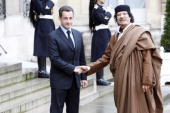 French President Nicolas Sarkozy welcomes Colonel Gaddafi at Le palais de l'Elysee on December 10 2007 in Paris France The Libyan leader Muammar...