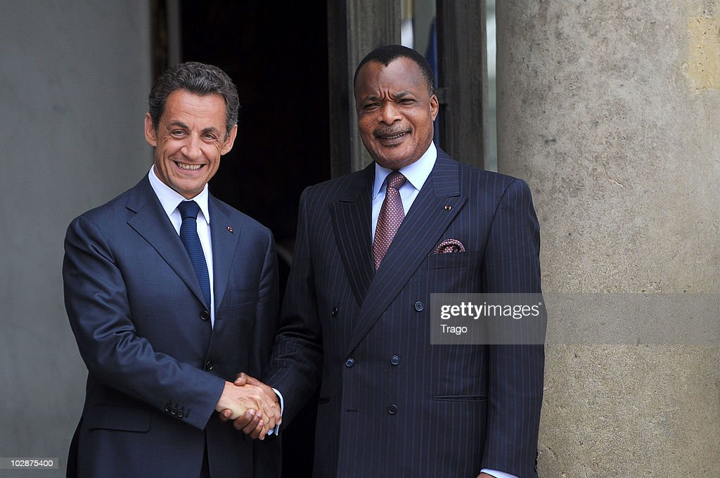French President <a gi-track='captionPersonalityLinkClicked' href=/galleries/search?phrase=Nicolas+Sarkozy&family=editorial&specificpeople=211375 ng-click='$event.stopPropagation()'>Nicolas Sarkozy</a> (L) welcomes Congolese President <a gi-track='captionPersonalityLinkClicked' href=/galleries/search?phrase=Denis+Sassou+Nguesso&family=editorial&specificpeople=4126626 ng-click='$event.stopPropagation()'>Denis Sassou Nguesso</a> at the Elysee Palace on July 13, 2010 in Paris, France. Fifty years after their independence, 13 African countries are invited to parade with French troops for the French national celebration, Bastille Day, which will take place on July 14, 2010 on the Champs Elysees in Paris.
