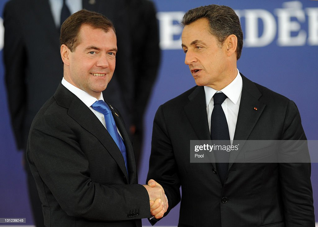 French President Nicolas Sarkozy (R) welcomes Russian President Dimitry Medvedev to the G20 Summit on November 3, 2011 in Cannes, France. World's top economic leaders are attending the G20 summit in Cannes on November 3rd and 4th, and are expected to debate current issues surrounding the global financial system in the hope of fending off a global recession and finding an answer to the Eurozone crisis.