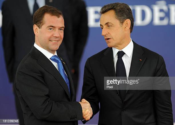 French President Nicolas Sarkozy welcomes Russian President Dimitry Medvedev to the G20 Summit on November 3 2011 in Cannes France World's top...