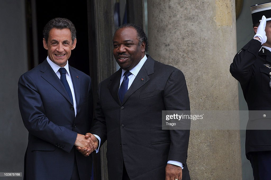 French President <a gi-track='captionPersonalityLinkClicked' href=/galleries/search?phrase=Nicolas+Sarkozy&family=editorial&specificpeople=211375 ng-click='$event.stopPropagation()'>Nicolas Sarkozy</a> (L) welcomes the President of Gabon <a gi-track='captionPersonalityLinkClicked' href=/galleries/search?phrase=Ali+Bongo+Ondimba&family=editorial&specificpeople=6166342 ng-click='$event.stopPropagation()'>Ali Bongo Ondimba</a> at the Elysee Palace on July 13, 2010 in Paris, France. Fifty years after their independence, 13 African countries are invited to parade with French troops for the French national celebration, Bastille Day, which will take place on July 14, 2010 on the Champs Elysees in Paris.