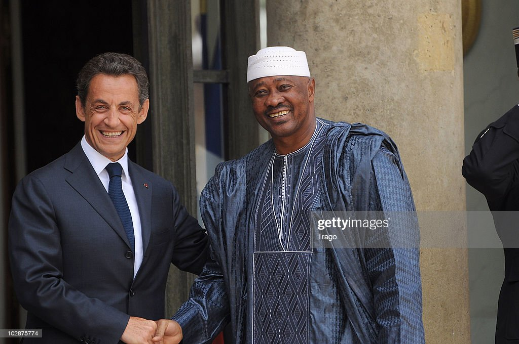 French President <a gi-track='captionPersonalityLinkClicked' href=/galleries/search?phrase=Nicolas+Sarkozy&family=editorial&specificpeople=211375 ng-click='$event.stopPropagation()'>Nicolas Sarkozy</a> (L) welcomes the president of Mali <a gi-track='captionPersonalityLinkClicked' href=/galleries/search?phrase=Amadou+Toumani+Toure&family=editorial&specificpeople=600956 ng-click='$event.stopPropagation()'>Amadou Toumani Toure</a> at the Elysee Palace on July 13, 2010 in Paris, France. Fifty years after their independence, 13 African countries are invited to parade with French troops for the French national celebration, Bastille Day, which will take place on July 14, 2010 on the Champs Elysees in Paris.