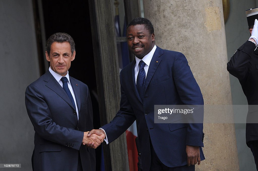 French President Nicolas Sarkozy (L) welcomes the President of Togo Faure Gnassingbe at the Elysee Palace on July 13, 2010 in Paris, France. Fifty years after their independence, 13 African countries are invited to parade with French troops for the French national celebration, Bastille Day, which will take place on July 14, 2010 on the Champs Elysees in Paris.
