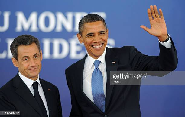 French President Nicolas Sarkozy welcomes US President Barak Obama to the G20 Summit on November 3 2011 in Cannes France World's top economic leaders...