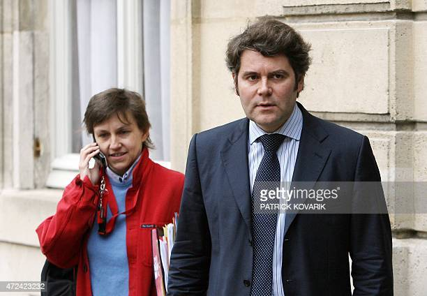 French president Nicolas Sarkozy's communication and press advisor Franck Louvrier and cabinet director Emmanuelle Mignon leave the Elysee palace 17...