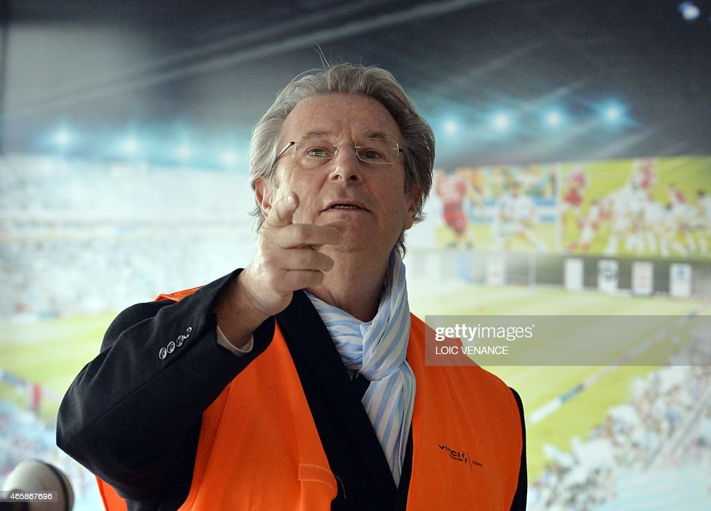 French president of Racing Metro 92 rugby club <a gi-track='captionPersonalityLinkClicked' href=/galleries/search?phrase=Jacky+Lorenzetti&family=editorial&specificpeople=6871513 ng-click='$event.stopPropagation()'>Jacky Lorenzetti</a> talks to journalists prior to visit the site of the Arena stadium, on March 11, 2015 in Nanterre, outside Paris. AFP PHOTO / LOIC VENANCE
