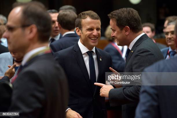 French President of Republic Emmanuel Macron smiles as he talks with Luxembourg Prime minister Xavier Bettel in Brussels on October 19 2017 during...