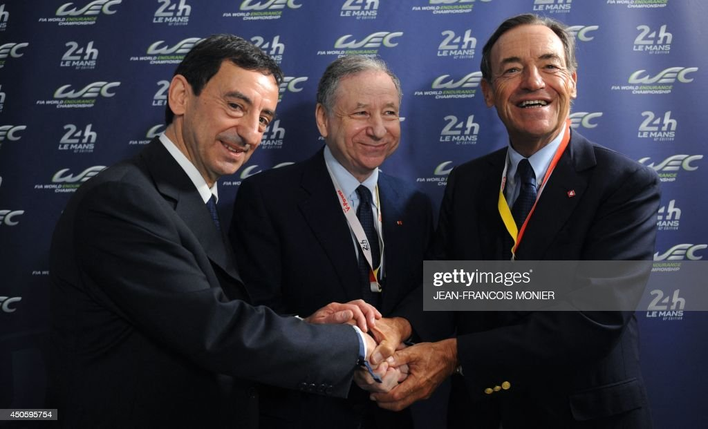 French President of the Automobile Club de lOuest (ACO) Pierre Fillon, in charge of the organisation of the Le Mans 24-hours endurance race, FIA President Jean Todt and Sir Lindsay Owen-Jones shake hands after a press conference announcing the continuation of the agreements ACO / FIA for the Wolrd Endurance Championship, the before the start of the 82nd Le Mans 24 hours endurance race, on June 14, 2014 in Le Mans, western France. Fifty-four cars with162 drivers will participate on June 14 and 15 in the Le Mans 24-hours endurance race. AFP PHOTO / JEAN FRANCOIS MONIER