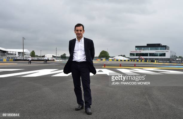 French President of the Automobile Club de lOuest Pierre Fillon in charge of the organisation of the Le Mans 24hours endurance race poses next to the...