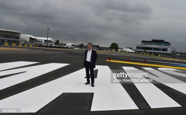 French President of the Automobile Club de lOuest Pierre Fillon in charge of the organisation of the Le Mans 24hours endurance race poseson the logo...