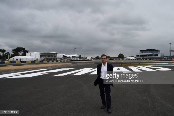 French President of the Automobile Club de lOuest Pierre Fillon in charge of the organisation of the Le Mans 24hours endurance race poses on the logo...