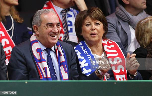 French President of the French Tennis Federation Jean Gachassin and Mayor of Lille Martine Aubry attend day one of the Davis Cup tennis final between...
