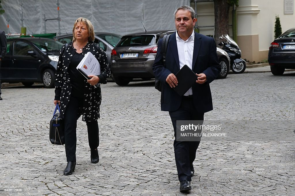 French President of the Hauts-de-France region Xavier Bertrand (R) and Mayor of Calais, Natacha Bouchart (L) arrive in Paris on June 29, 2016 for a meeting on the migrant crisis in Calais. / AFP / MATTHIEU