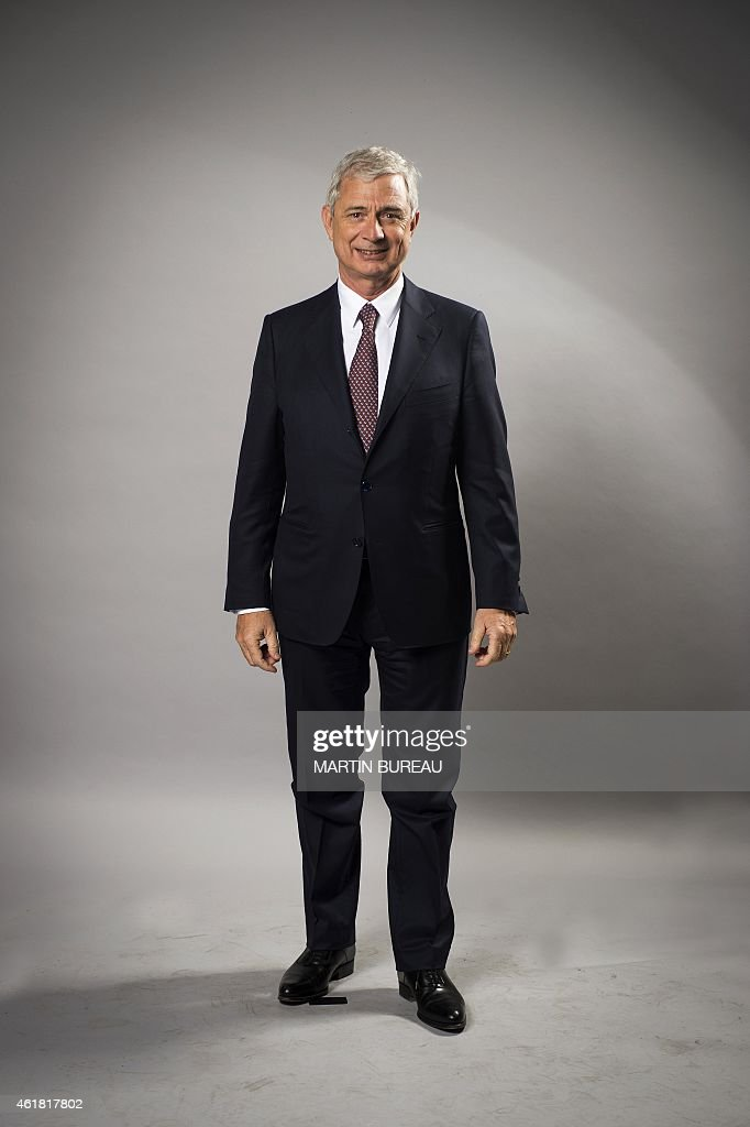 French president of the national assembly <a gi-track='captionPersonalityLinkClicked' href=/galleries/search?phrase=Claude+Bartolone&family=editorial&specificpeople=551950 ng-click='$event.stopPropagation()'>Claude Bartolone</a>, poses on January 19, 2015 in Paris, during a photocall for the 70th anniversary of the news agency Agence France Presse.