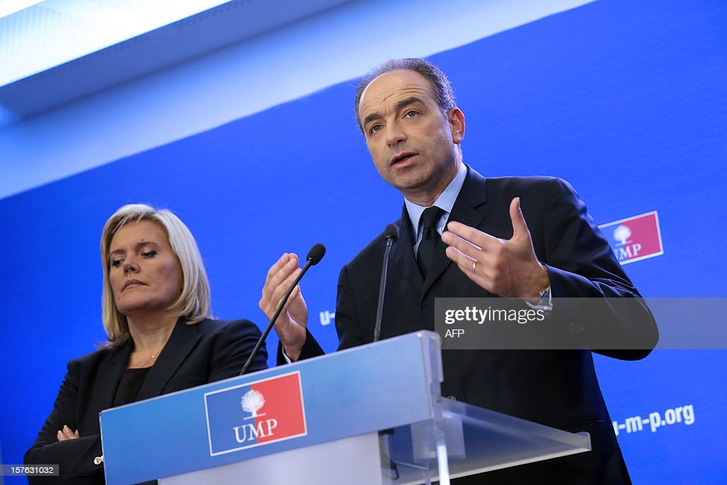 French President of the Union for a Popular Movement right-wing opposition party (UMP) Jean-Francois Cope (C), flanked by party's General Secretary Michele Tabarot (L), holds a press conference on December 5, 2012 at the party headquarters in Paris. Cope denounced the 'guilty silence' of the governement towards his ecologist ally concerning the Flamanville nuclear plant, northwestern France. French energy group EDF raised recently the total cost of its long-delayed new-generation nuclear reactor at Flamanville by 2 billion euro (2.6 billion US dollar) to 8.5 billion (10.3 billion US dollar). Built by French energy giant Areva and due to be operated by EDF, it is one of four European Pressurised Reactor projects in the world, including another much-delayed one planned in Finland.