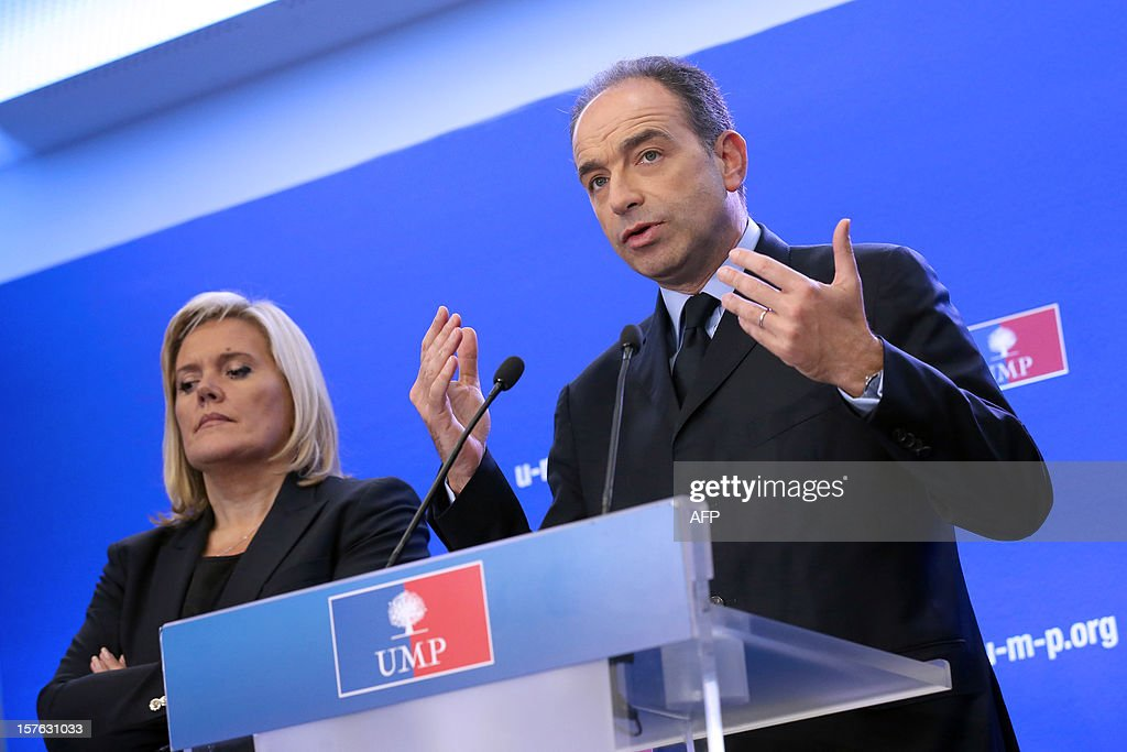 French President of the Union for a Popular Movement right-wing opposition party (UMP) Jean-Francois Cope (C), flanked by party's General Secretary Michele Tabarot (L), holds a press conference on December 5, 2012 at the party headquarters in Paris. Cope denounced the 'guilty silence' of the governement towards his ecologist ally concerning the Flamanville nuclear plant, northwestern France. French energy group EDF raised recently the total cost of its long-delayed new-generation nuclear reactor at Flamanville by 2 billion euro (2.6 billion US dollar) to 8.5 billion (10.3 billion US dollar). Built by French energy giant Areva and due to be operated by EDF, it is one of four European Pressurised Reactor projects in the world, including another much-delayed one planned in Finland. AFP PHOTO / THOMAS SAMSON